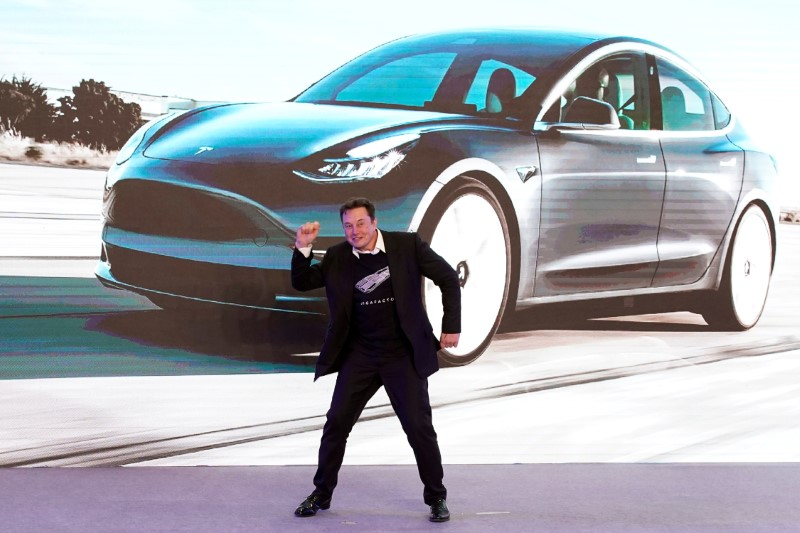 FILE PHOTO: Tesla Inc CEO Elon Musk dances onstage during a delivery event for Tesla China-made Model 3 cars in Shanghai
