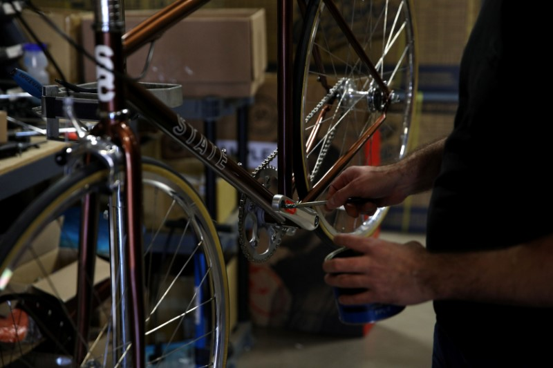 Gabe Ortiz services one of the company's products at State Bicycle in Tempe