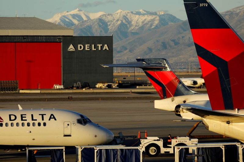 FILE PHOTO: A Delta Air Lines flight is pushed put of its gate at the airport in Salt Lake City