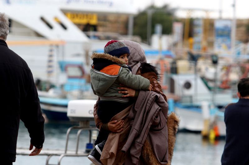 Syrian refugees are seen after disembarking from a Cyprus coast guard boat off the south-east of the island in the region of Protaras