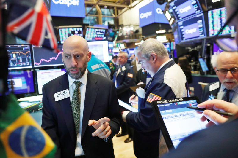 United States stocks edge higher in midday, head for weekly gains