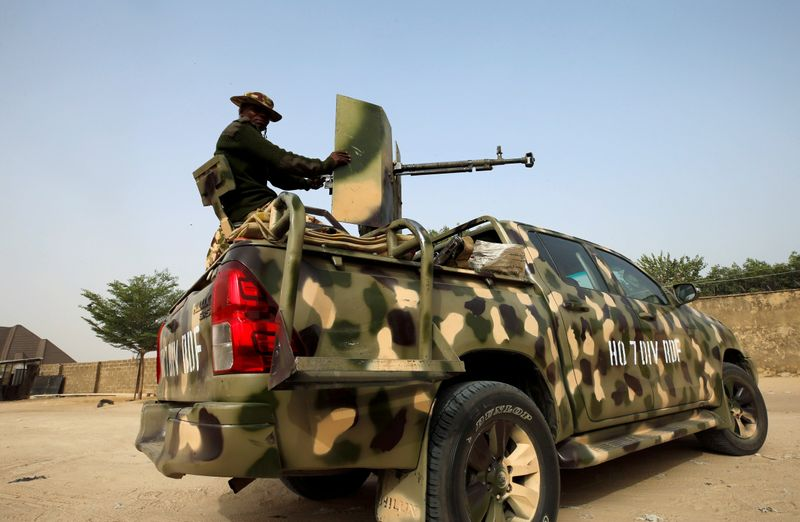 FILE PHOTO: Nigerian military prepare to cordon the area where a man was killed by suspected militants during an attack around Polo area of Maiduguri