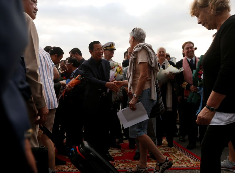 Cambodia's Prime Minister Hun Sen welcomes passengers of MS Westerdam, a cruise ship that spent two weeks at sea after being turned away by five countries over fears that someone aboard might have the coronavirus , as it docks in Sihanoukvil