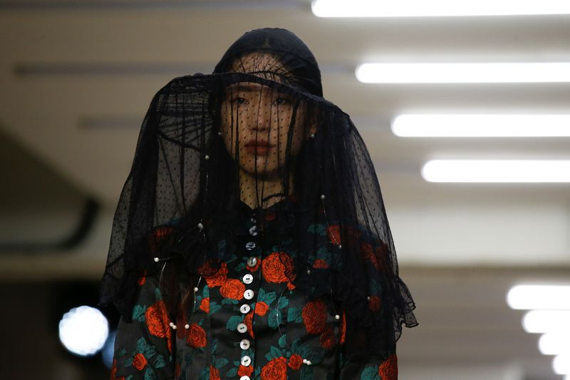 Model presents creation during the Yuhan Wang catwalk show at London Fashion Week in London
