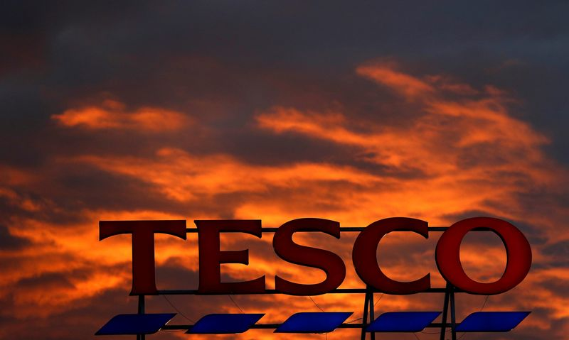 A company logo is pictured outside a Tesco  supermarket in Altrincham northern England.