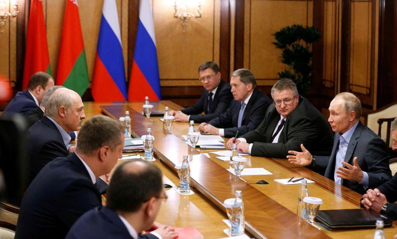 FILE PHOTO: Russian President Vladimir Putin and Belarusian President Alexander Lukashenko talk during their meeting in the Black sea resort of Sochi