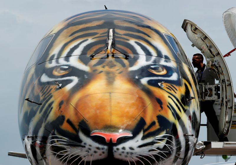 FILE PHOTO: Embraer E-190 E2 aircraft featuring a spray painted tiger's face is displayed during a media preview of the Singapore Airshow