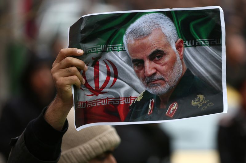 Iranian holds a picture of late General Qassem Soleimani in Tehran