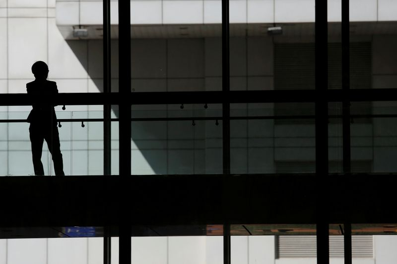 FILE PHOTO: A woman talks on phone inside the Bank of China head office building in Beijing