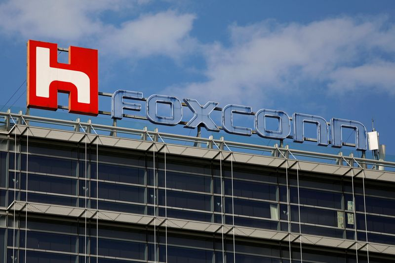 The logo of Foxconn, the trading name of Hon Hai Precision Industry, is seen on top of the company's building in Taipei