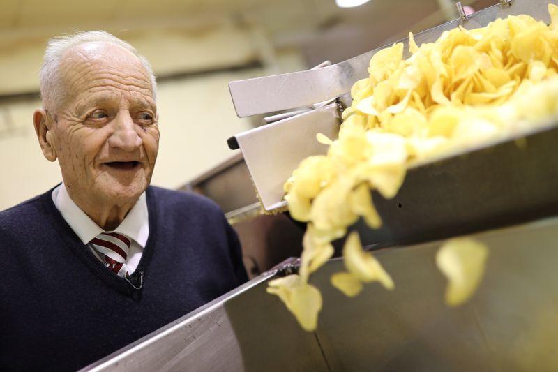 Bonilla, 87, looks at potato chip production during interview with Reuters inside his Bonilla a la Vista factory in Arteixo
