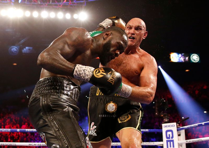 Tyson Fury stops Deontay Wilder as corner throws in towel in 7th