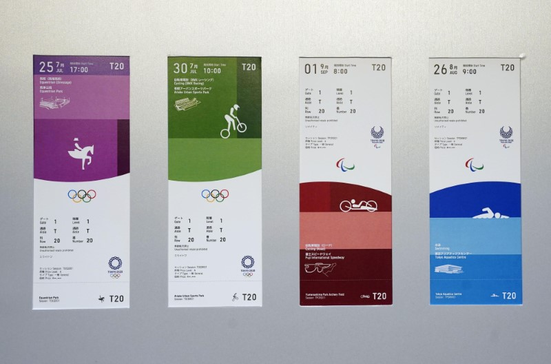 FILE PHOTO : The ticket designs for the 2020 Tokyo Olympics and Paralympics are seen displayed for the media for a photo opportunity in Tokyo, Japan