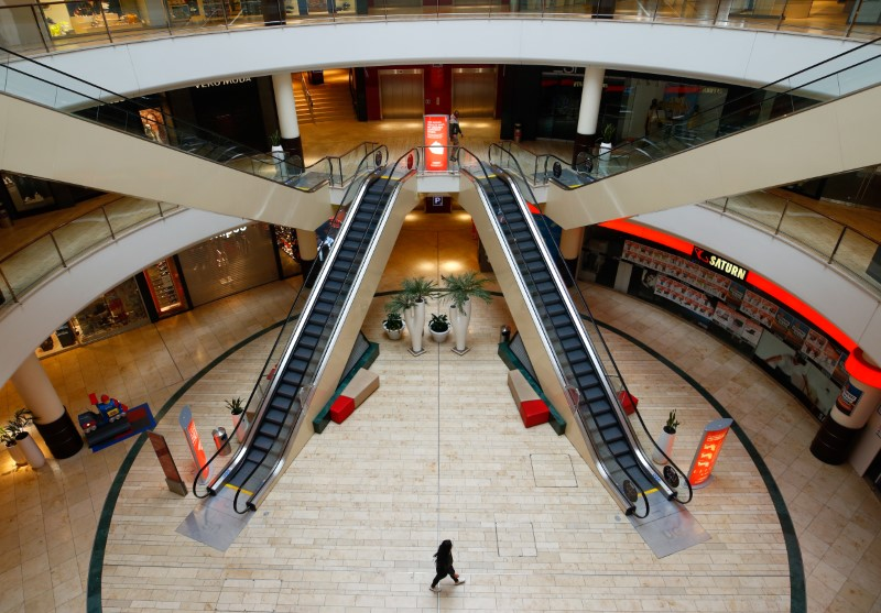 A person is seen inside an empty shopping mall during a partial lockdown in Leverkusen