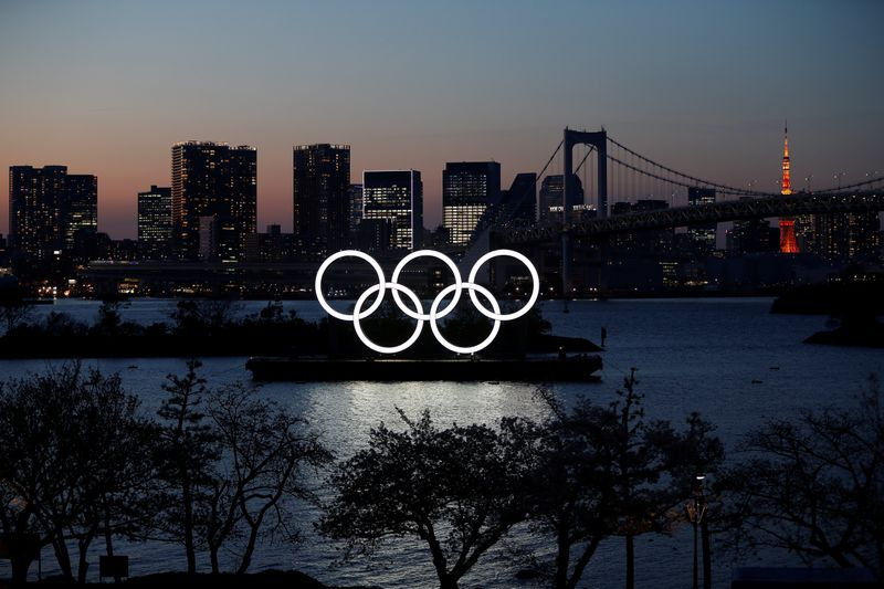 The giant Olympic rings are seen in the dusk at the waterfront area at Odaiba Marine Park after postponing Games due to the outbreak of coronavirus disease (COVID 19), in Tokyo
