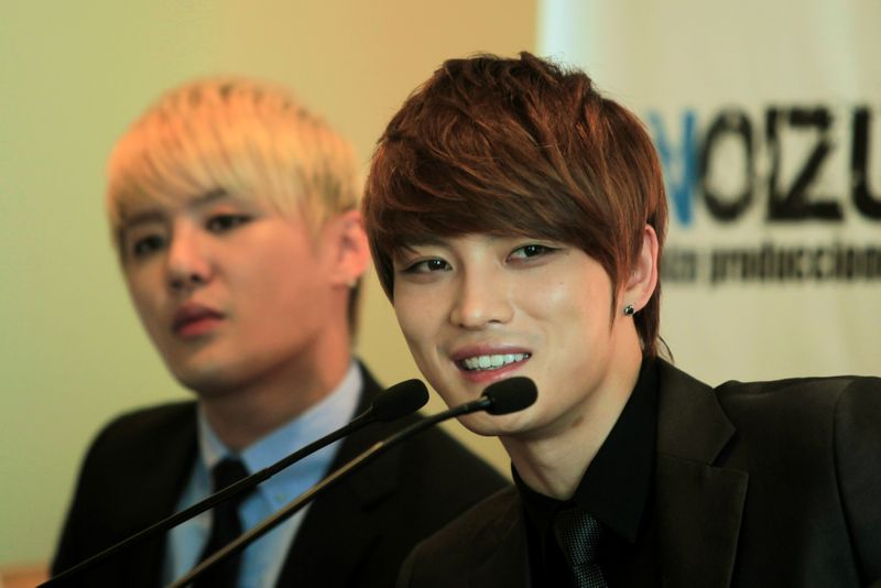 FILE PHOTO: Kim Jaejoong (R) of South Korean pop group JYJ speaks to a news conference in Lima, Peru
