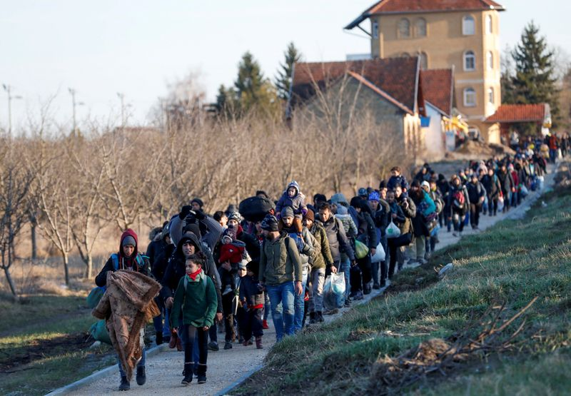 FILE PHOTO: Migrants protest in Serbia's north to demand a passage to the EU