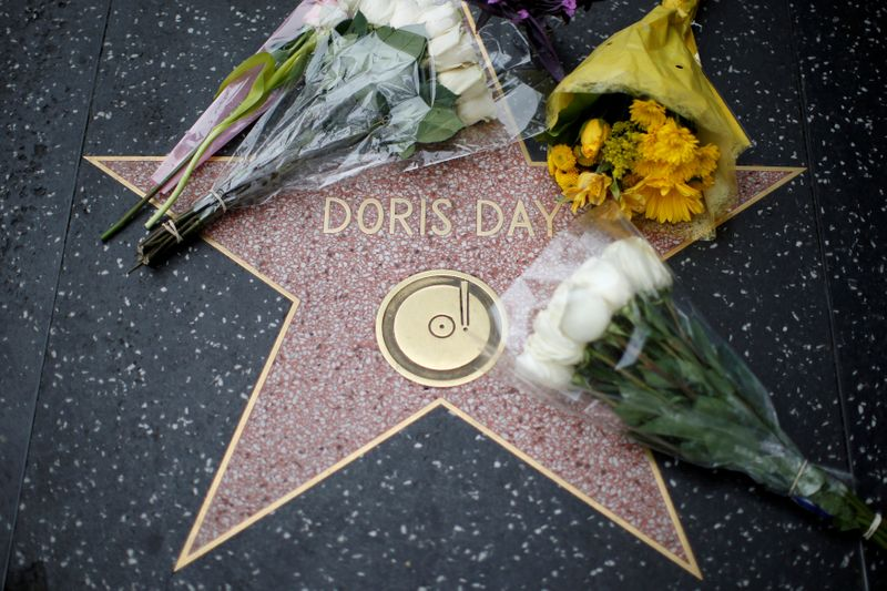 FILE PHOTO: Flowers are pictured by the star of late actor Doris Day on the Hollywood Walk of Fame in Los Angeles