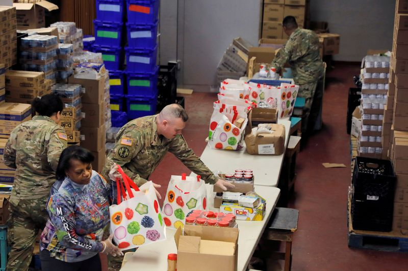 FILE PHOTO: Members of the New York Army National Guard help pack pantry bags for food distribution with Hope Community Services in an area with multiple cases of the coronavirus disease (COVID-19) in New Rochelle, New York
