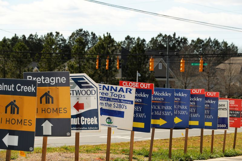 Real estate signs advertise new homes for sale in multiple new developments in York County, South Carolina