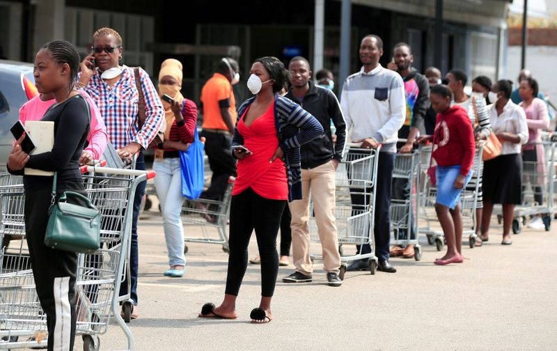FILE PHOTO: People queue to shop ahead of a nationwide 21 day lockdown called by the government to limit the spread of coronavirus disease (COVID-19) in Harare