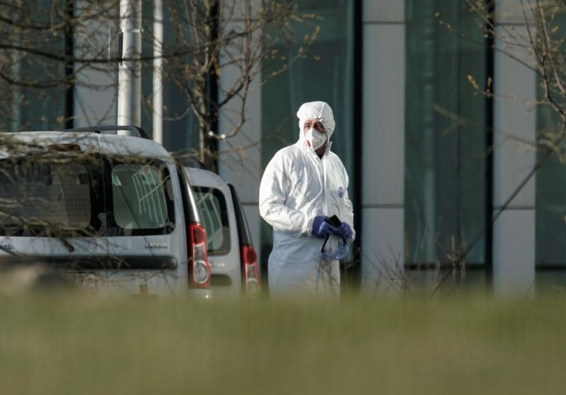 A medical specialist stands outside a hospital for patients infected with the coronavirus disease on the outskirts of Moscow