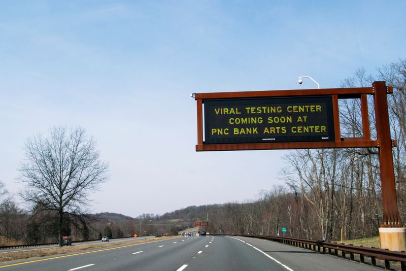 Roadside screen gives information about testing center for coronavirus disease (COVID-19), in Holmdel, NJ