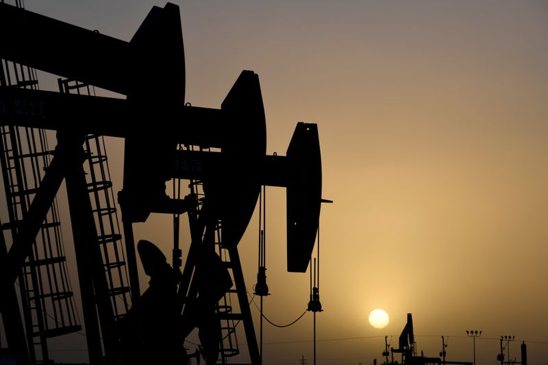 FILE PHOTO: FILE PHOTO: Pump jacks operate at sunset in Midland, Texas