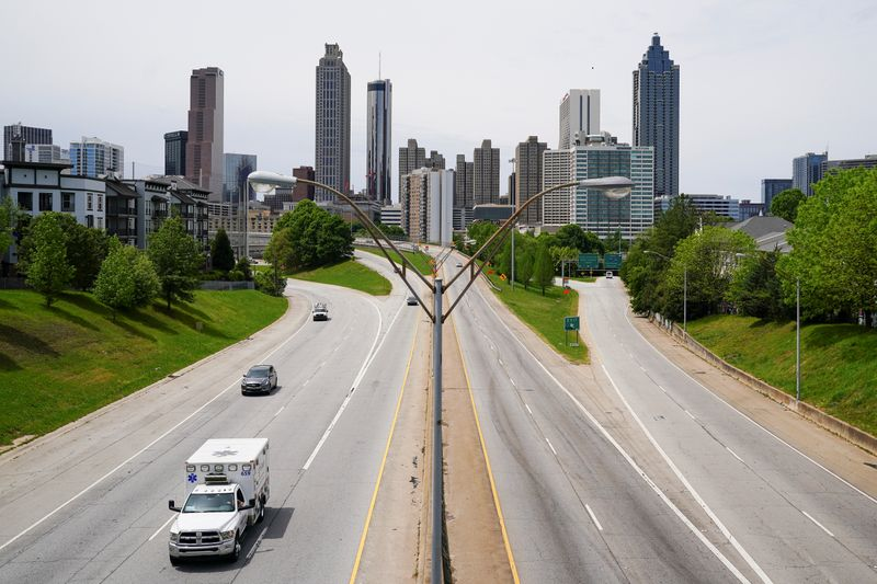 An ambulance is seen in the foreground of the Atlanta skyline days before the phased reopening of businesses from coronavirus disease rules in Atlanta