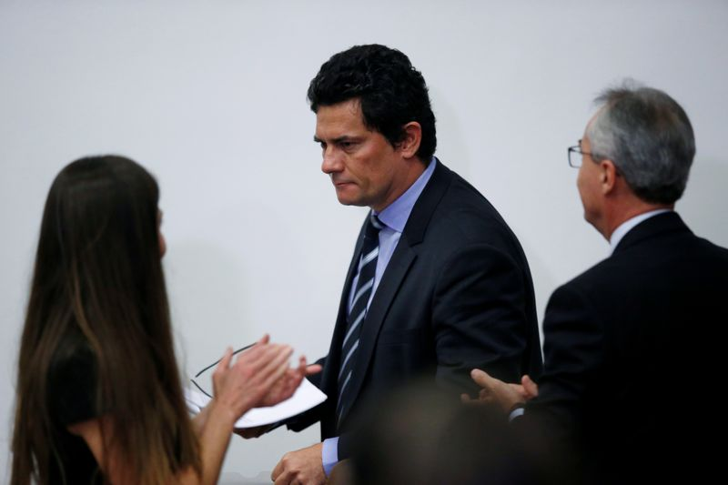 Brazil's Justice Minister Sergio Moro leaves a news conference in Brasilia
