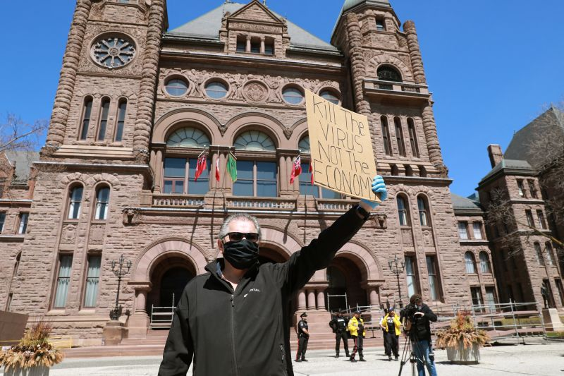 Protesters demand the removal of the provincial coronavirus disease restrictions in Toronto