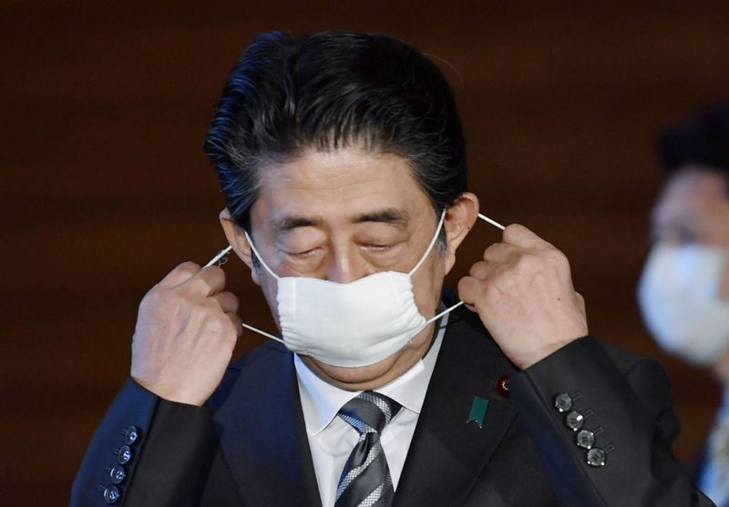 Japan to restart some public facilities after state of emergency extended