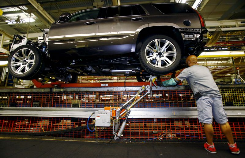 FILE PHOTO: Mike Guillen works on the assembly line at the General Motors Assembly Plant in Arlington, Texas