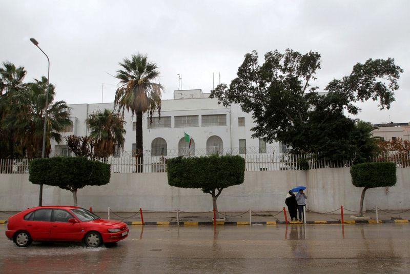 FILE PHOTO: Car drives past the Italian embassy in Tripoli