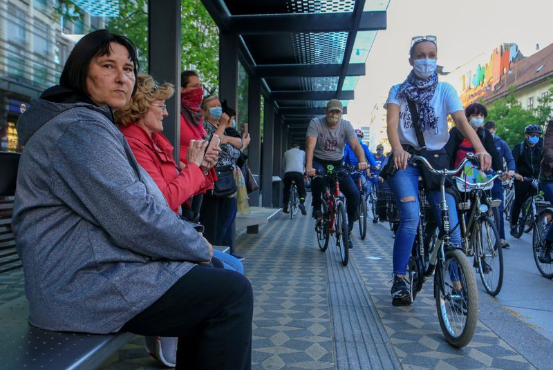 Protesters ride bicycles during an anti-government protest in Ljubljana