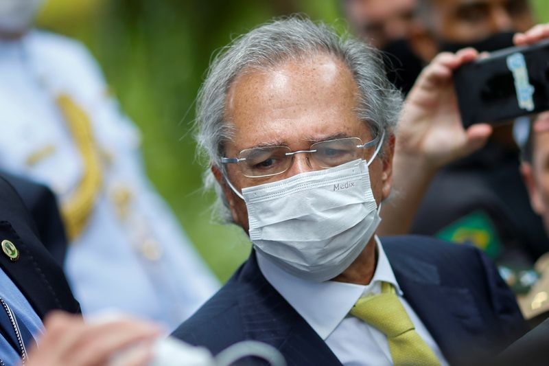 FILE PHOTO:  Brazil's Economy Minister Paulo Guedes wears a protective mask during a news conference after a meeting with President of Brazil's Supreme Federal Court Dias Toffoli, amid the coronavirus disease (COVID-19) outbreak in Brasilia