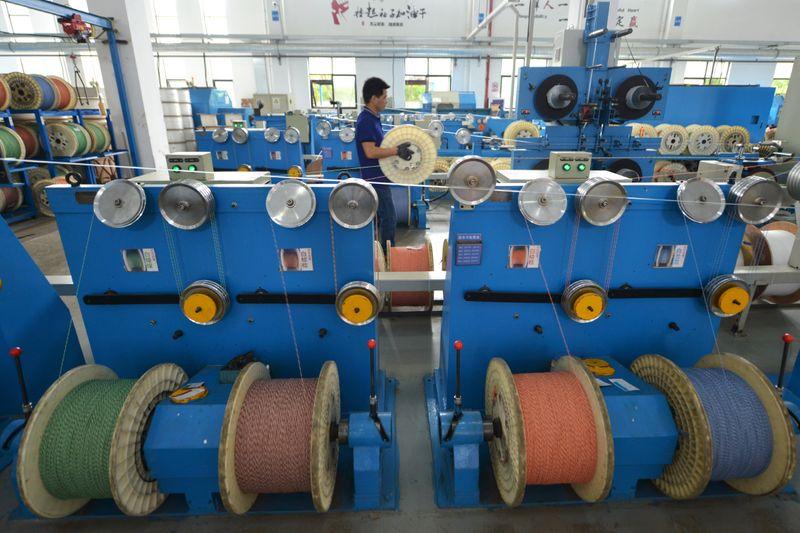 Employee works at a factory of the Zhejiang Headway Communication Equipment Co in Huzhou