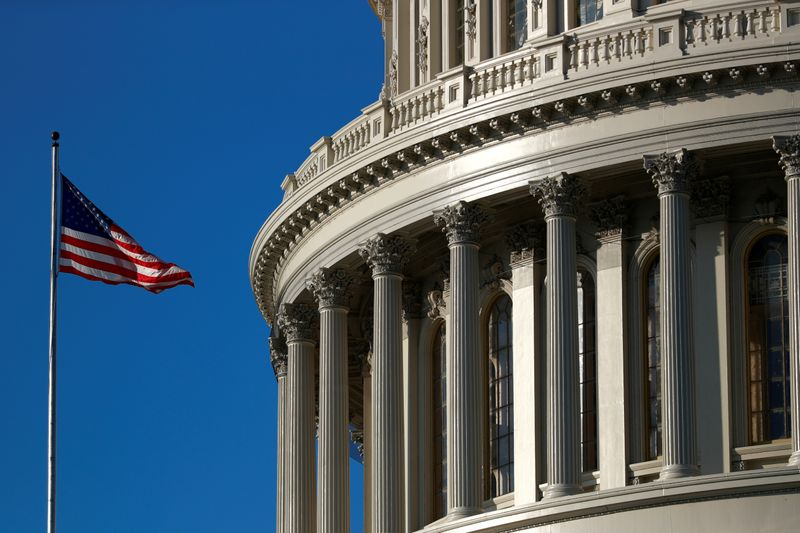 FILE PHOTO: A U.S. flag flies outside of the Capitol dome ahead of the House of Representatives resolution appointing managers for Trump impeachment trial