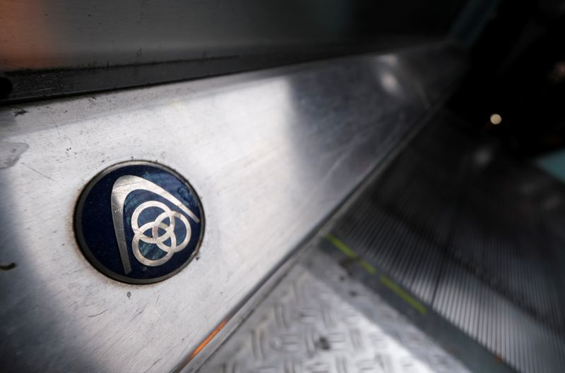FILE PHOTO: The logo of German steelmaker ThyssenKrupp AG is seen on an escalator at Frankfurt's main railways station in Frankfurt