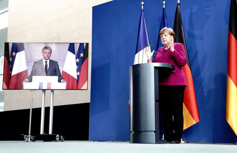 German Chancellor Angela Merkel holds a joint video news conference with French President Emmanuel Macron