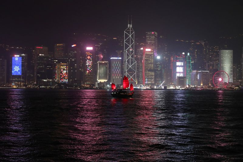 The Hong Kong skyline is lit up on Christmas Eve in Hong Kong