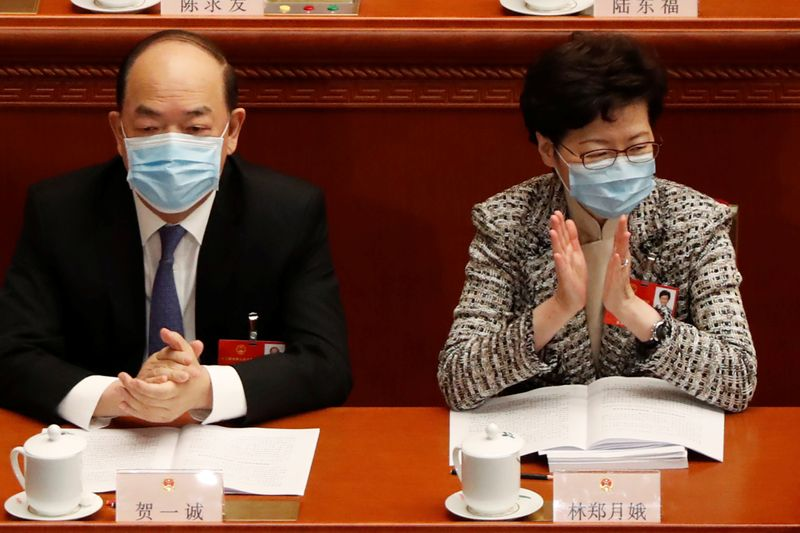 Hong Kong Chief Executive Carrie Lam and Macau Chief Executive Ho Iat-seng attend the opening session of NPC in Beijing