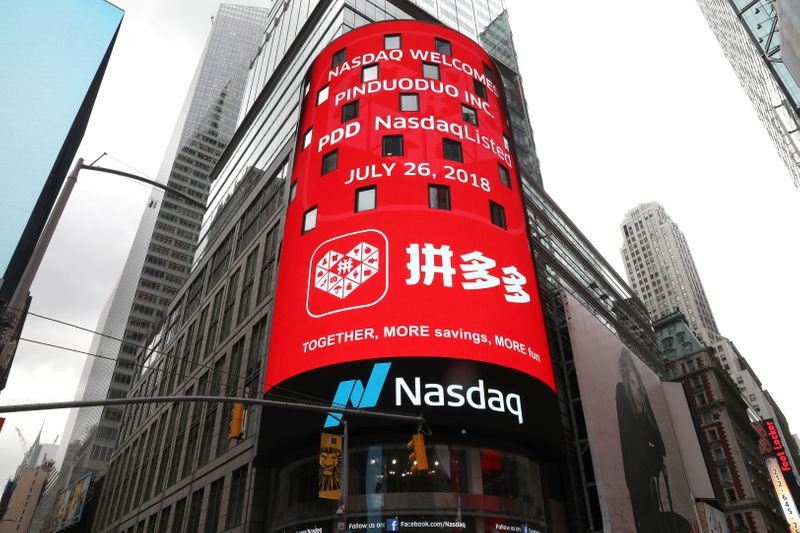 FILE PHOTO:  A display at the Nasdaq Market Site shows a message after Chinese online group discounter Pinduoduo Inc. (PDD) was listed on the Nasdaq exchange in Times Square in New York City
