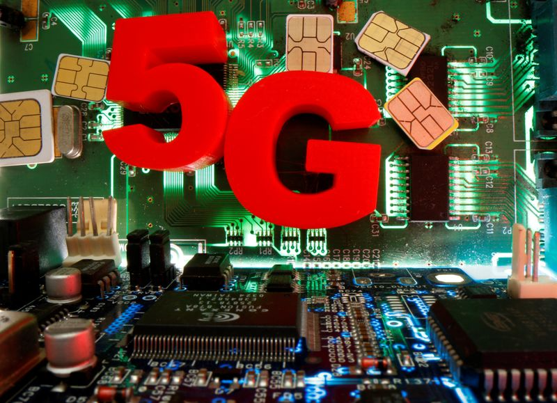 FILE PHOTO:  SIM cards and 3d printed objects representing 5G are put on a motherboard in this picture illustration