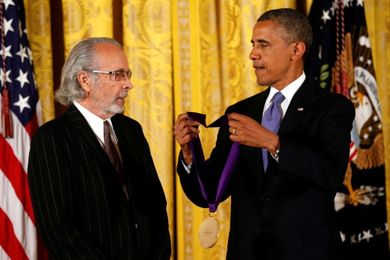 FILE PHOTO: U.S. President Barack Obama awards the 2012 National Medal of Arts to musician Herb Alpert during a ceremony in Washington