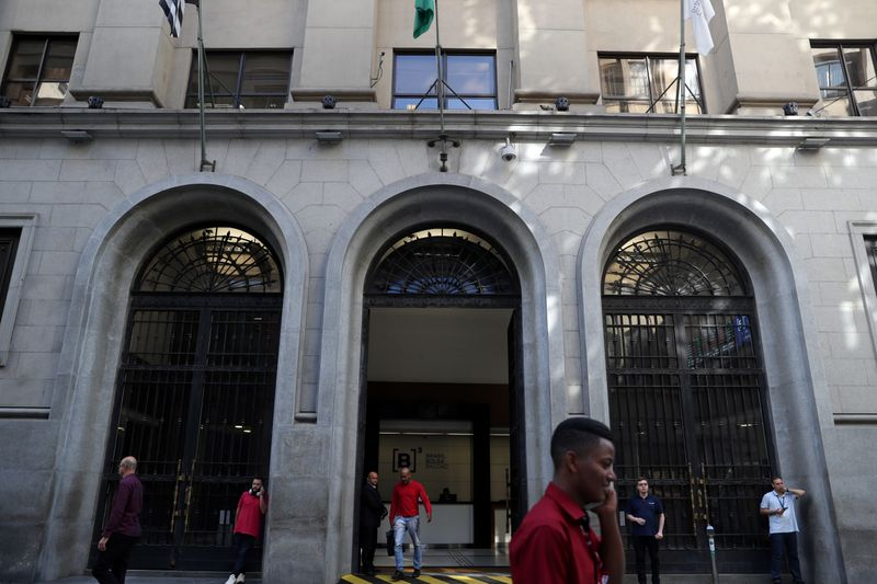 People walk past Brazil's B3 Stock Exchange building in downtown Sao Paulo