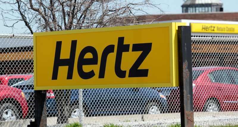 FILE PHOTO: A Hertz rental car sign is placed outside a rental lot near Detroit Metropolitan airport in Romulus