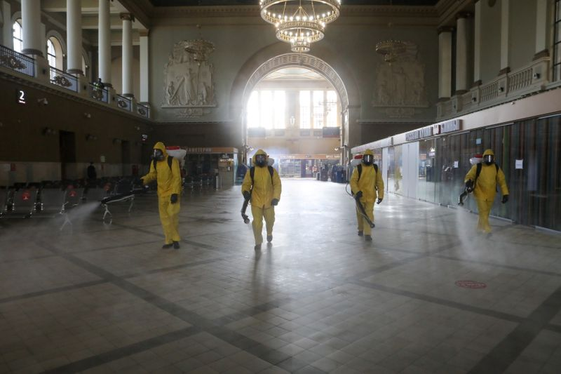 FILE PHOTO: Emergencies Ministry members sanitize a railway station amid the outbreak of the coronavirus disease in Moscow