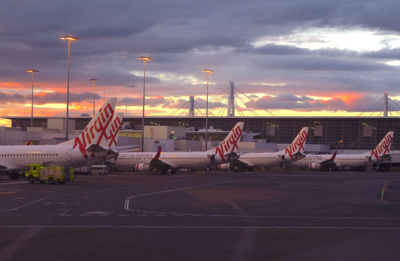 FILE PHOTO: Aircraft from Australia's second largest airline, Virgin Australia, sit on the tarmac at the domestic terminal of Sydney Airport