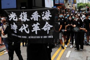 Hong Kong police fire tear gas on biggest protests since COVID curbs